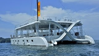 Jumping into the ocean from a two story Ocean-King-Catamaran