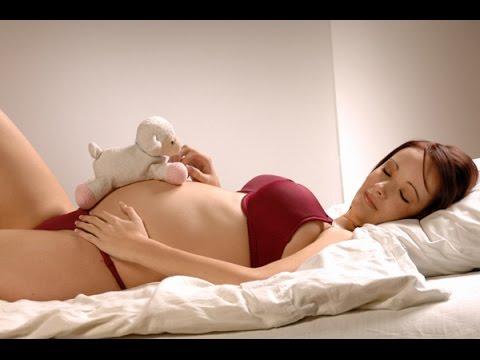 Ways to sleep to reduce back pain while pregnant