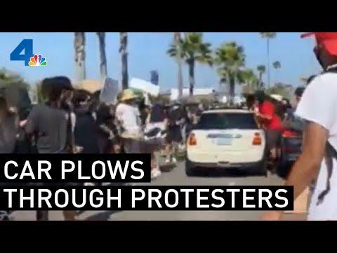mini-cooper-drives-through-crowd-of-protesters-in-newport-beach- -nbcla