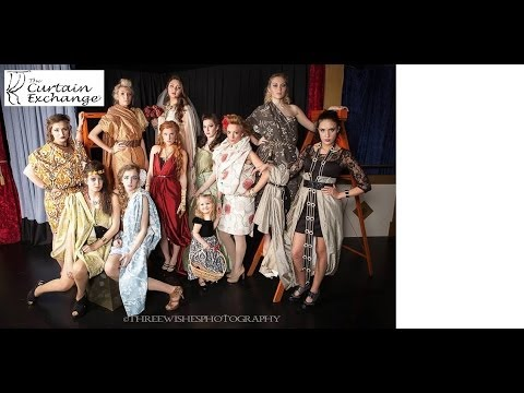 Project Runway fashions made from curtains strut the stage.