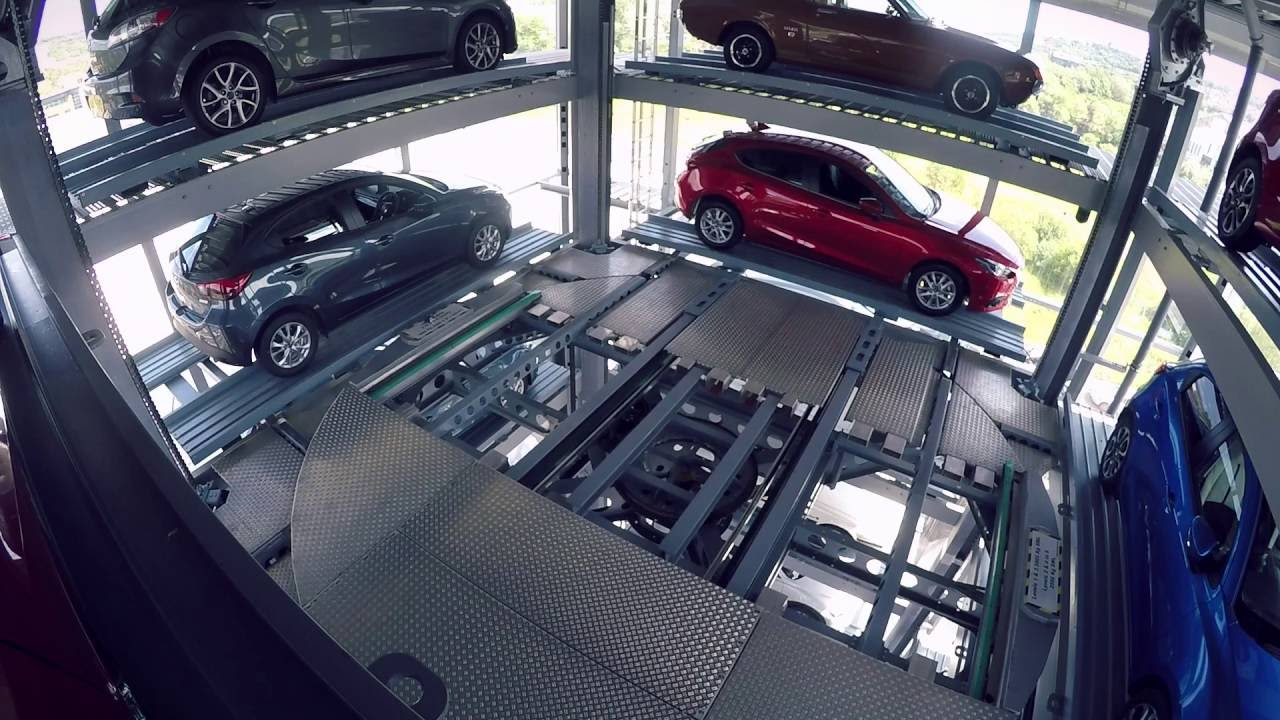 Autopod solutions uk hodgson motor group car display tower for Auto solutions motor company