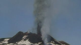 Plumes of black smoke erupt from Mount Etna