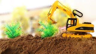 รถแมคโครปลูกต้นไม้บนเนินเขา รถดั้มบรรทุกต้นไม้ Excavator & digger
