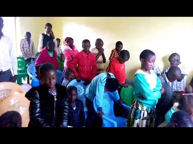 Haron Praying for Children in Fellowhip 8 24 2018