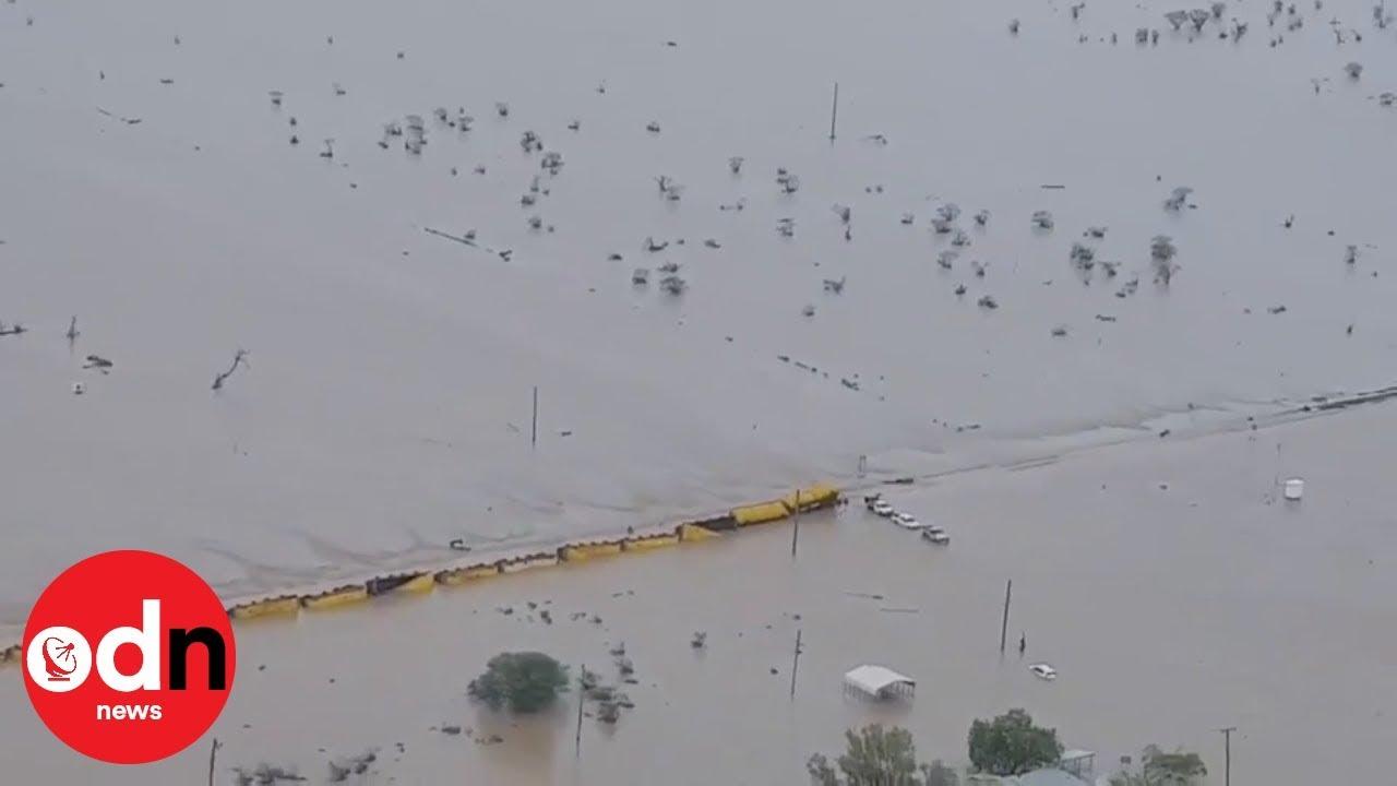 Flooding derails huge 80-wagon freight train in Australia