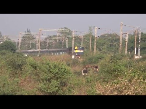 Impressive Looking Rajkot Coimbatore Express Passes Through Quiet Locale Near Sanjan Railway Bridge