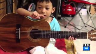 3 YO baby boy singing and playing guitar (Little fingers co
