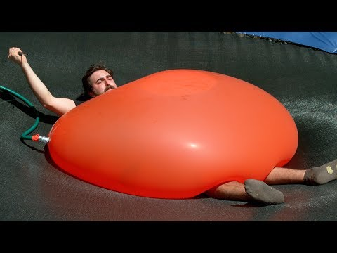 Crushed by a Giant 6ft Water Balloon - 4K - The Slow Mo Guys