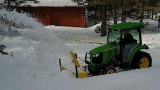 John Deere 3039R Snowblowing