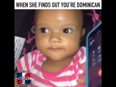 Cute dominican baby hangs up phone
