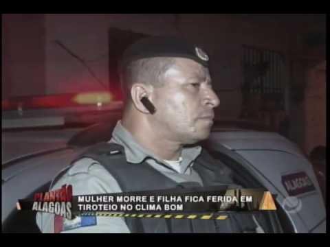 MULHER É MORTA DENTRO DE CASA E FILHA É BALEADA NA MÃO