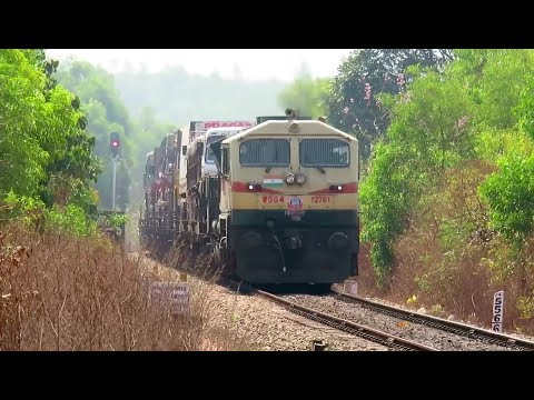 Thumbnail: COUNT THE TRUCKS ON TRAIN : Exceptional Konkan Railway : Unique RO-RO Service Knocks Kumta !!