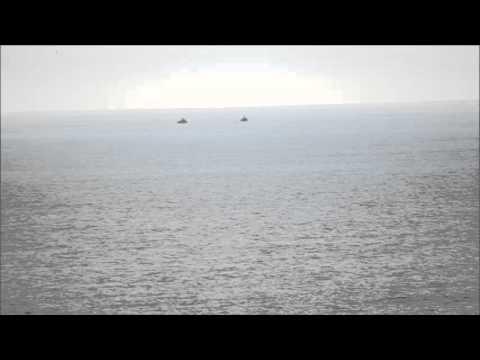 Israeli naval forces arresting Palestinian fishermen in Gaza water, March 11, 2014