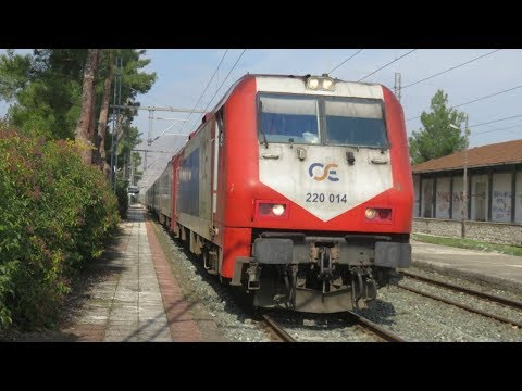 Greece: A pair of TrainOSE Class 220 diesel locos leave Livadia on a Thessaloniki - Athens IC train