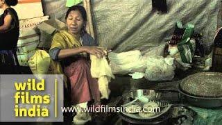 Lady makes sweet steamed rice cake - Guwahati