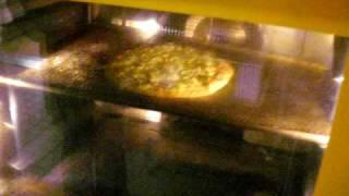 Schwingende Pizza