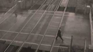 Man dodges a train at a level-crossing in Essex
