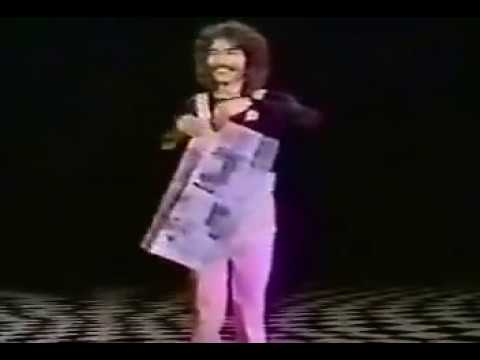 Doug Henning performing the Torn & Restored paper illusion