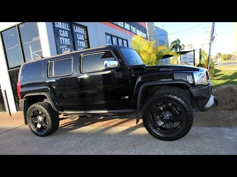 Hummer H3 custom rims 20 inch KMC Rockstar black wheels