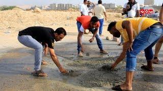 مبادرة مجتمعية لردم الحفر في شوارع المكلا | تقرير معتز النقيب |  يمن شباب