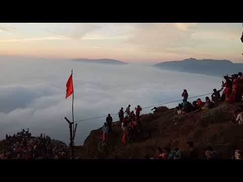 Sunrising on the velliangiri top hill among clouds