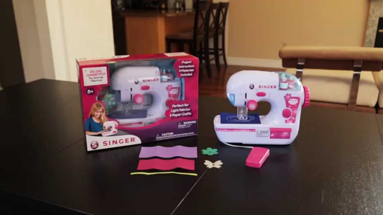 Singer battery operated chain stitch sewing machine manual.