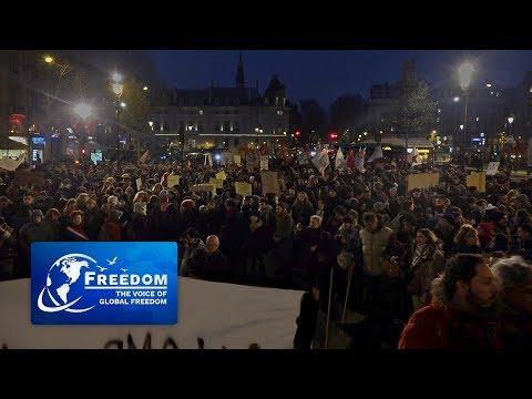 Thousands Protest Against New Immigration and Asylum Law in Paris
