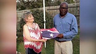 Confederate flag tears a neighborhood apart before it comes together
