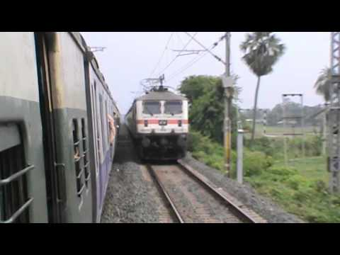 Passengers watch in amazement, as furious WAP-7 Howrah New Delhi Duronto rockets away overtaking EMU