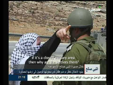 Israeli army attacks  and arrests palestinian woman before her kids
