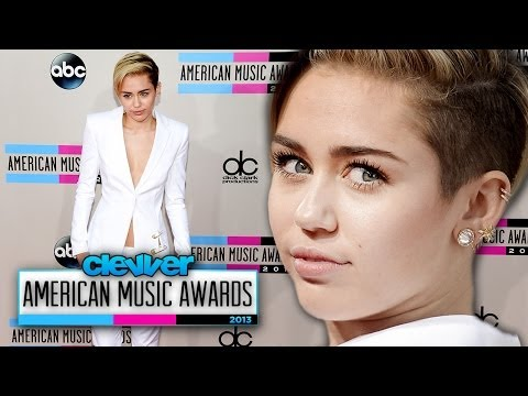 Miley Cyrus Glows In White Pant Suit At American Music Awards 2013