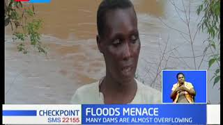 Rivers breaking banks, roads impassable and dams overflowing as heavy rains rage on