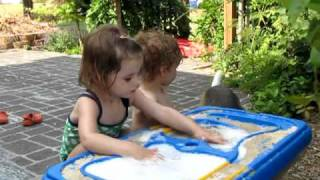 Kids Playing At Water Table