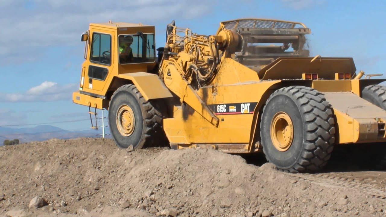 Komatsu Pc220lc Excavator Working A Dirt Hill Then A Cat