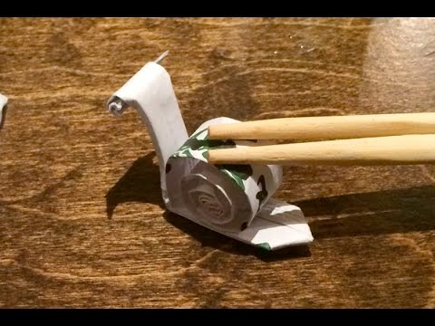 Origami Snail Chopstick Rest Folded Out Of A Chopstick Wrapper