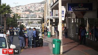 Part of Cape Town's CBD was on lockdown after two armed men robbed the cash crusaders in strand street forcing a traffic to be rerouted. Police say two men, armed with a gun and a knife stormed the second hand goods store forcing the terrified staff to the back of the shop. The search continues for the two suspects who fled the scene with only a cellphone.   Click here to subscribe to Eyewitness news:http://bit.ly/EWNSubscribe  Like and follow us on:http://bit.ly/ EWNFacebookANDhttps://twitter.com/ewnupdates  Read full article on Eyewitness news:Ihttp://ewn.co.za/2017/07/05/police-search-for-suspects-after-cape-town-cbd-robbery  Keep up to date with all your local and international news:www.ewn.co.za  Produced by: Bertram Malgas