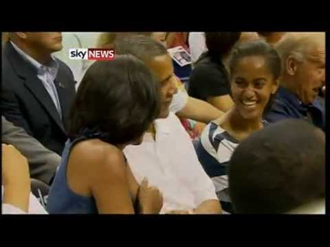 Download Michelle And Barack Obama Kiss At Basketball Game