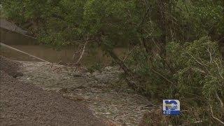 Flooding washes bridge away