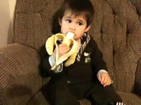One year old baby eating banana