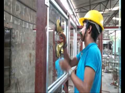 Glazing trained workers doing final practice before SEC(K) test