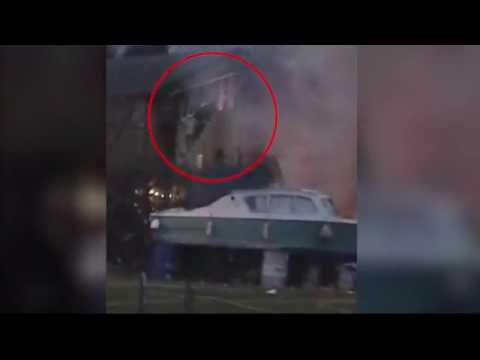 Moment firefighter rescues person from burning building in Oxford