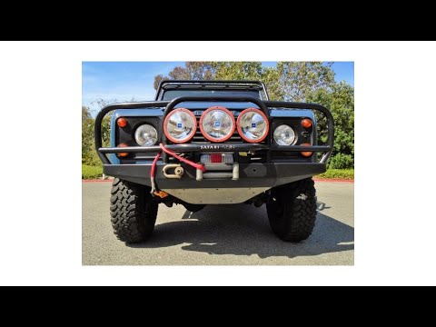 Excellent condition 1997 Land Rover Defender 90 Convertible offroad (photo slideshow)