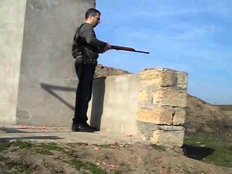 Пулевой патрон 12 калибра & стальной лист толщиной 10 мм.