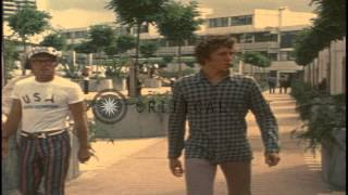 Athletes walk about in the Olympic village during the 1972 Summer Olympics held i...HD Stock Footage