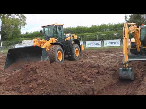 Hyundai excavator and wheel loader working