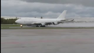 BOEING 747 , rainy windy TAKEOFF from liege