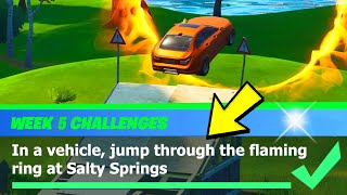 In a vehicle, jump through the flaming ring at Salty Springs Location - Fortnite Week 5 Challenge
