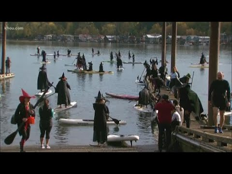 Hundreds attend Stand Up Paddleboard Witch Paddle in Portland