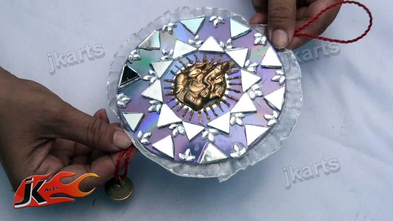 Car and wall hanging out of waste dvd diy how to make for Wall hanging best out of waste