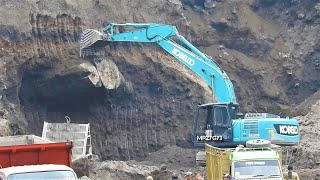 Kobelco SK200 10 Excavator Digging Falling The BIG Stone From The Sand Cliff